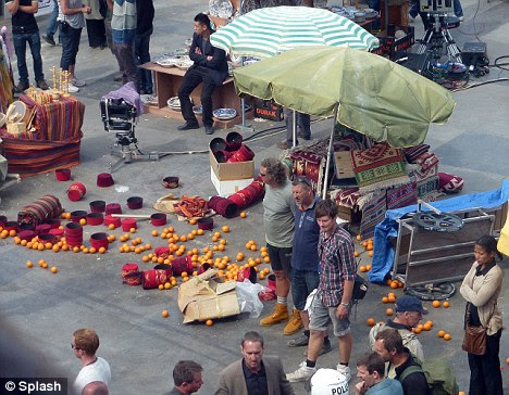What a mess: Craig's chase leaves an orange seller's stall in a right mess