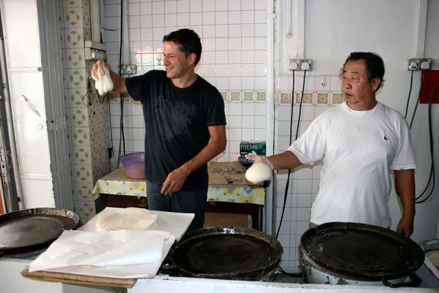 The popiah skin master on the right has been doing this for 40 years