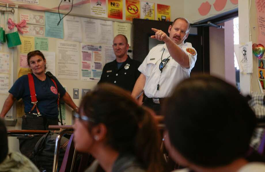Captain Zack TIbbets fields questions from students in Ali Mayer's 9-12  grade Health Education class at Abraham Lincoln High School on Monday, Oct. 5, 2015 in San Francisco, Calif. Photo: Nathaniel Y. Downes, The Chronicle