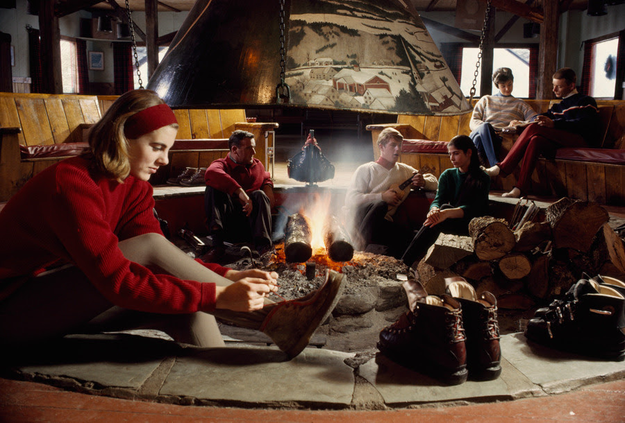 Skiers relax by a fire at a Stowe dormitory in Vermont, August 1967.Photograph by B. Anthony Stewart, National Geographic