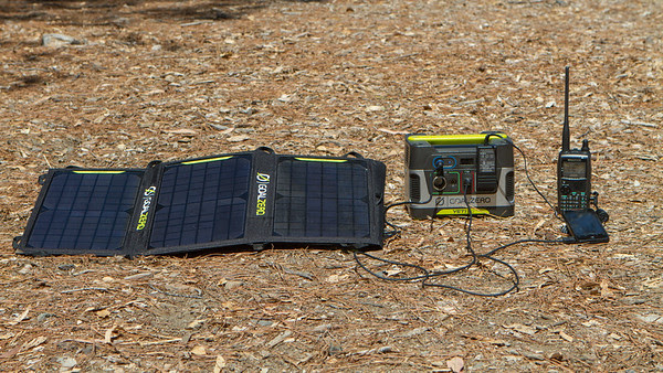 Goal Zero Yeti 150 Solar Generator and Nomad 20 Solar Panel charging electronics in the field.