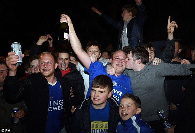 Victorious: Leicester fans celebrate outside Jamie Vardy's house after seeing their side crowned champions
