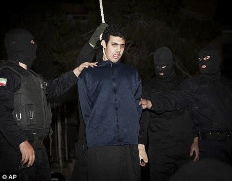 Execution: Iranian policemen prepare to publicly hang Mohammad Ali Sarvari in Tehran