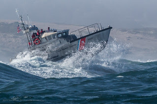 Coast Guard 47 foot Motor Lifeboat practicing in the big surf