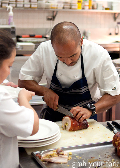 Chef JP Anglo carving the rolled pork belly at the Filipino Barbie