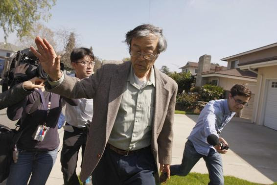Satoshi Nakamoto is surrounded by reporters as he leaves his home in Temple City, California, March 6, 2014. REUTERS/David McNew