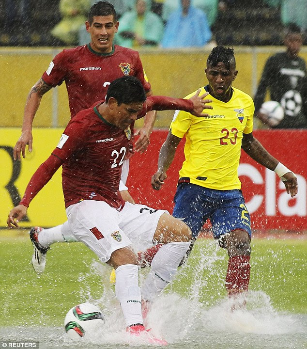 Bolivia's Edward Zenteno fights for the ball with both Bolanos and the woeful conditions in Quito