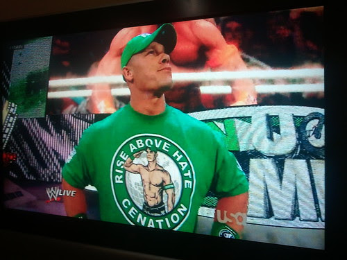 There is something about John Cena wearing a shirt with his shirtless image on it