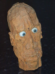 Carved wooden head with glass eyes