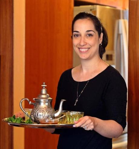 Liora Kushner, a Moroccan-Israeli caterer, serves mint tea.