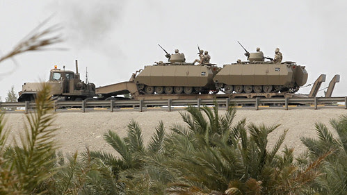 Tanks from the U.S.-backed monarchy in Saudi Arabia crossing over into Bahrain to assist in the suppression of mass demonstrations for reforms. The imperialists have not waged a campaign against the monarchy but have sought regime-change in Libya. by Pan-African News Wire File Photos