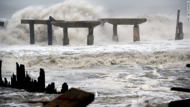 Waves crash against a previously damaged pier in Atlantic City, New Jersey, as Hurricane Sandy approaches landfall on Monday.