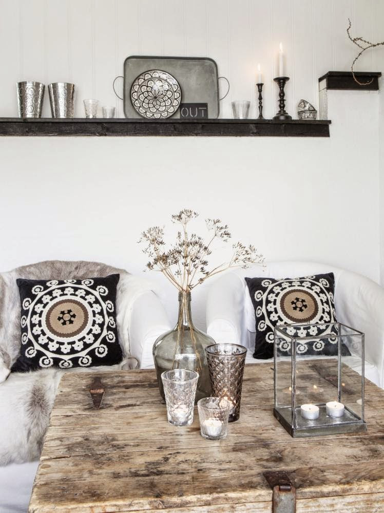 White slipcovered armchairs in a rustic Scandinavian cottage