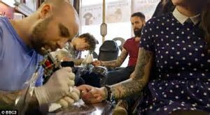 Heavily tattooed couple who married in front of 10,000