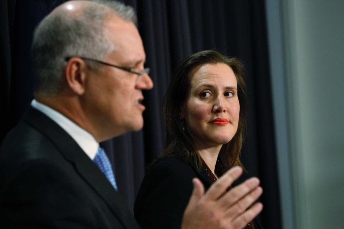 Kelly O'Dwyer looks at Scott Morrison during a press conference
