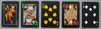 arpak four color playing cards black background
