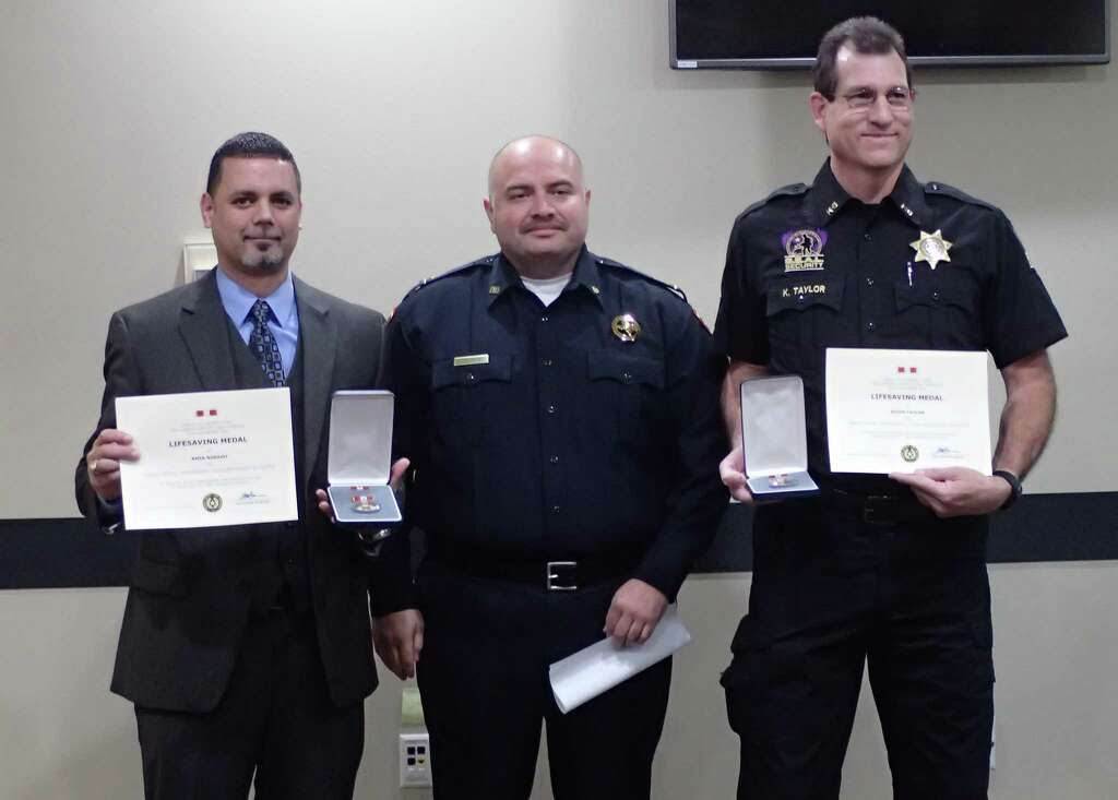 Kevin Taylor, Security Officer with S.E.A.L and Amin Rosano, an agent with the Drug Enforcement Administration, awarded a Life Saving Medal. Photo: Courtesy