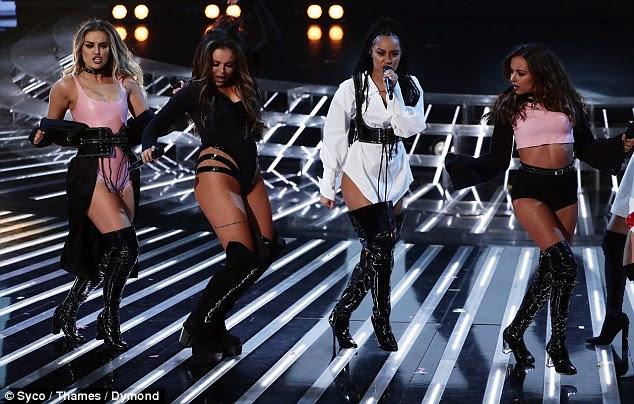 """Demais?  As meninas estavam bateu no Twitter para 'vestir como strippers """", como eles abalou botas de PVC e roupas minúsculas na noite de domingo"""