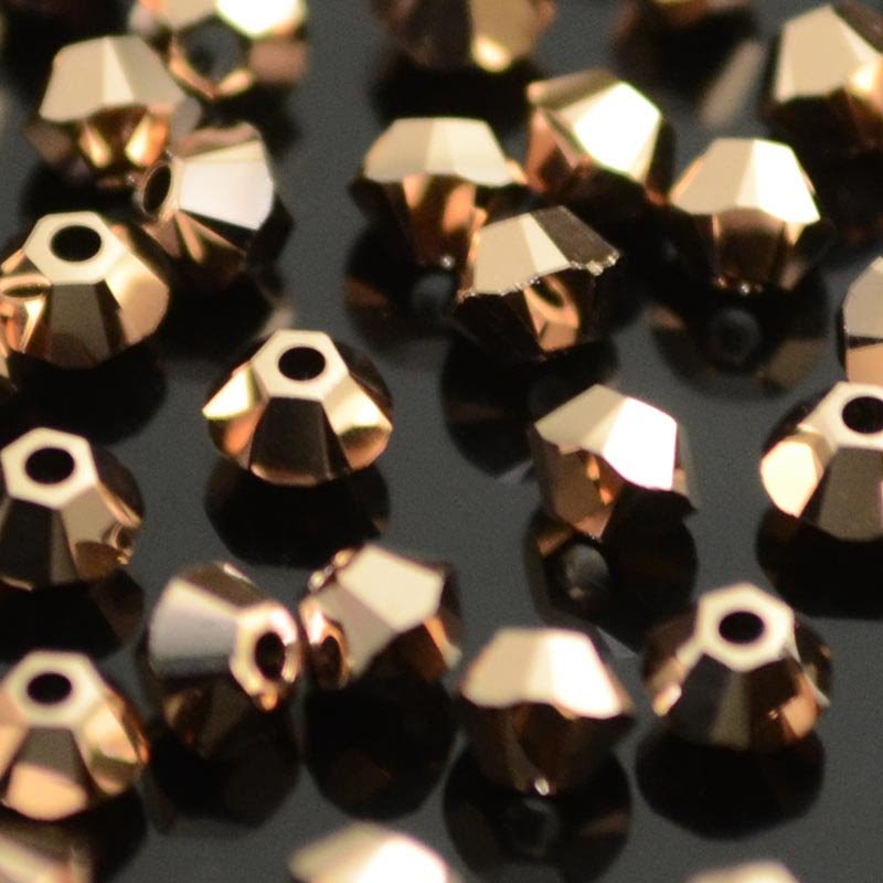 27753011192004 Swarovski Elements Bead - 3 mm Faceted Xilion Bicone (5328) - Crystal Rose Gold 2X (10)