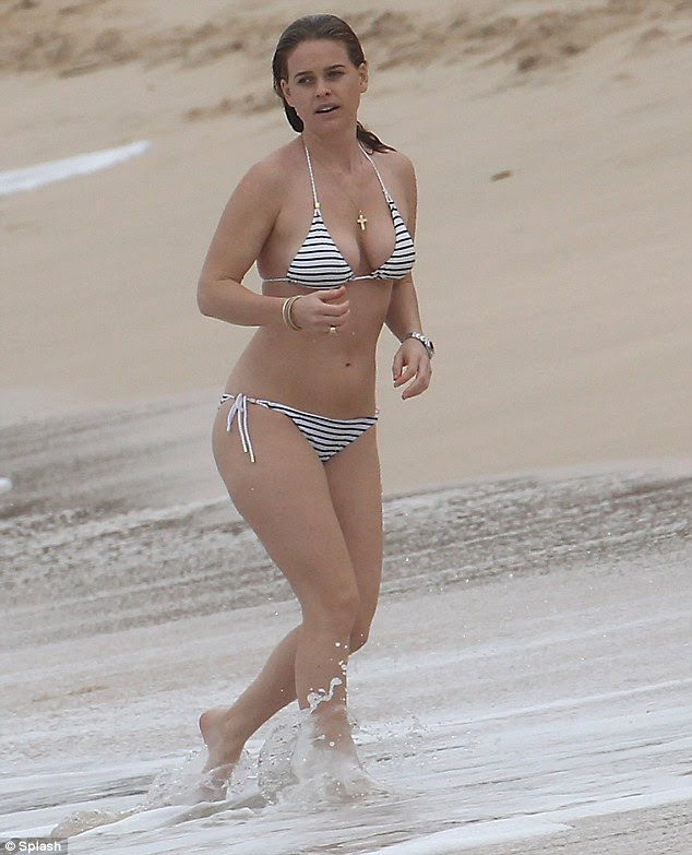 Every inch the beach babe: Alice Eve will have no doubt added to her legion of followers after parading her showstopping curves while on a festive family holiday in Barbados on Christmas Day
