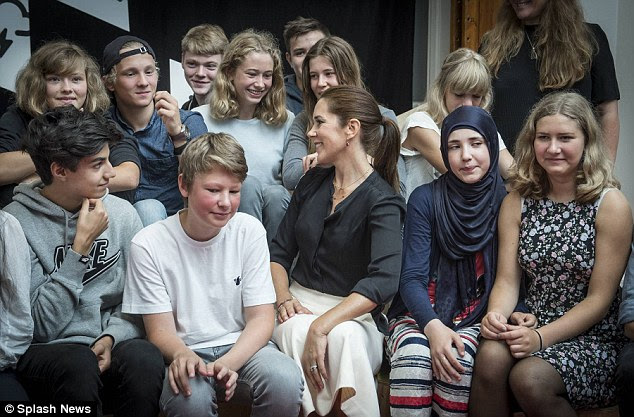 The 43-year-old was seen chatting and mingling among grade eight pupils at the Copenhagen academy