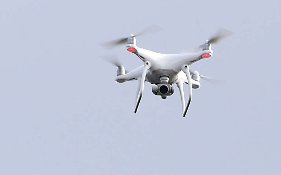 A drone is seen in this file photo at Lake George, N.Y. A drone operator was arrested Sunday's 49ers-Seahawk game, after attempting to distribute flyers to fans via drone. The same man also attempted to distribute flyers at the Oakland Coliseum, before he was arrested. Photo: Lori Van Buren / 20039281A