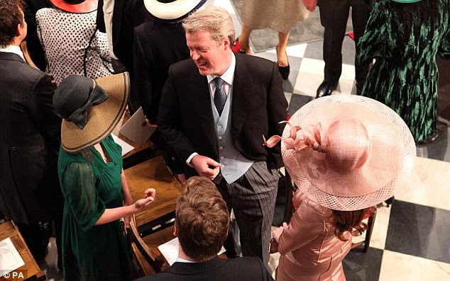 Earl Spencer talks to guests inside Westminster Abbey where guests were mingling ahead of the 11am ceremony