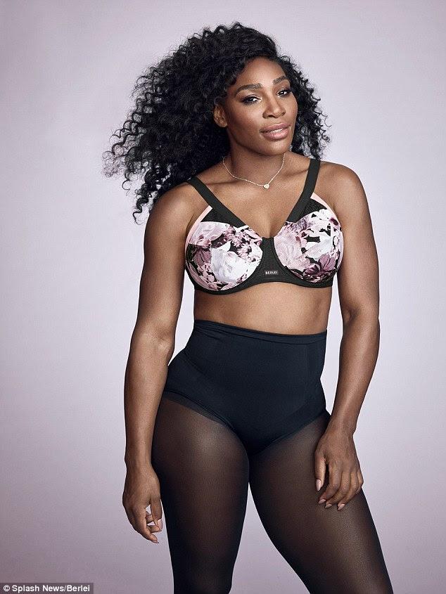 Toned: Ela mais tarde trocou para um sutiã floral rosa esportes como ela enfrentou na frente em seu próximo tiro, adicionando um toque feminino e exibindo seu abs ondulando mais claramente para a câmera