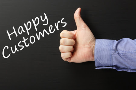 34150872 - the phrase happy customers written on a blackboard with a male hand wearing a business shirt giving the thumbs up gesture
