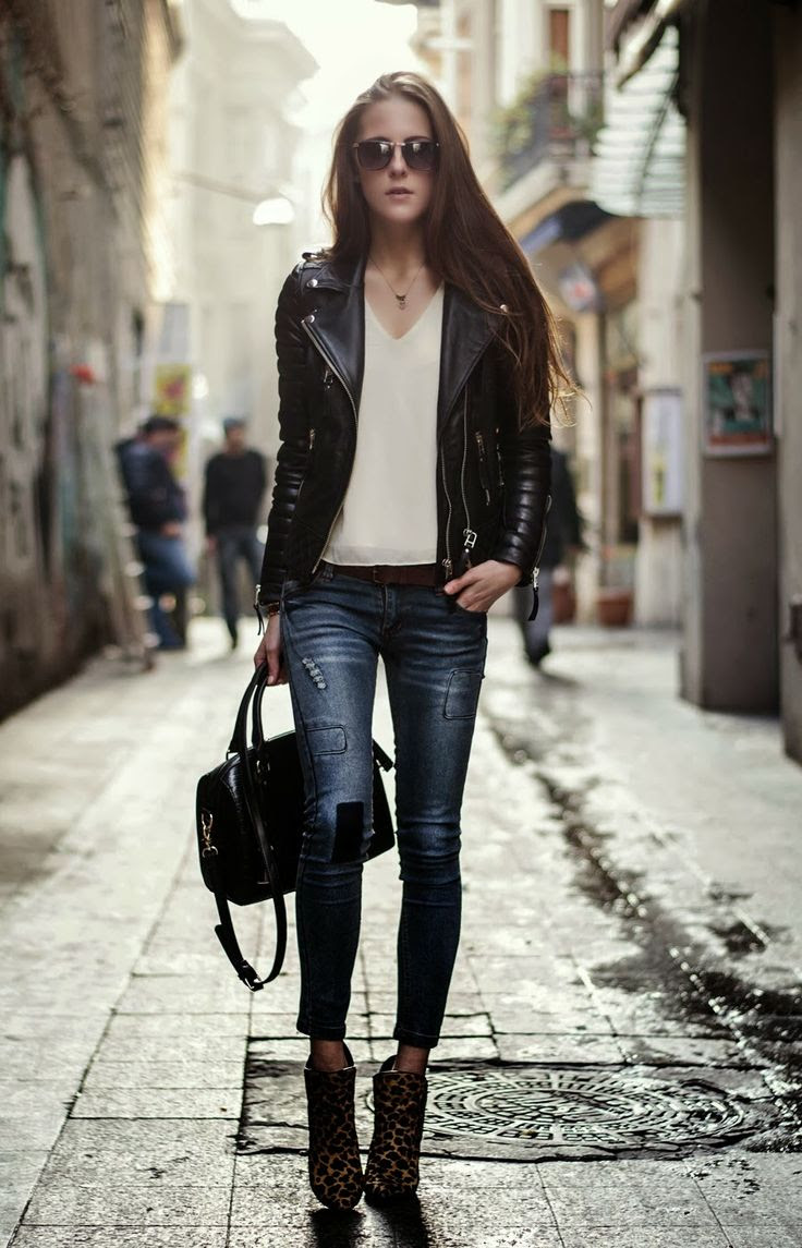 Black leather jacket with stylish jeans, leopard heels and handbag