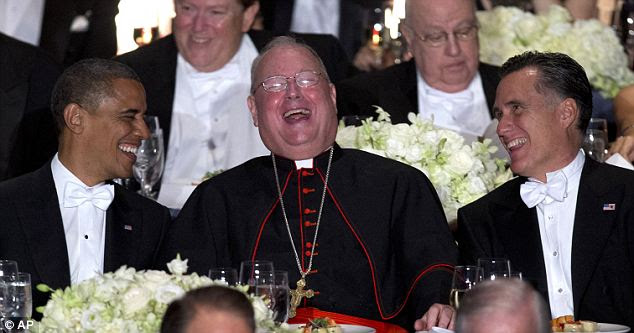 Laughing all the way to the White House: Obama and Romney share a joke with New York's Cardinal Timothy Dolan during the annual Al Smith dinner which has been attended by presidents since the Second World War
