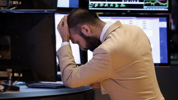 PHOTO: Specialist Fabian Caceres works on the floor of the New York Stock Exchange