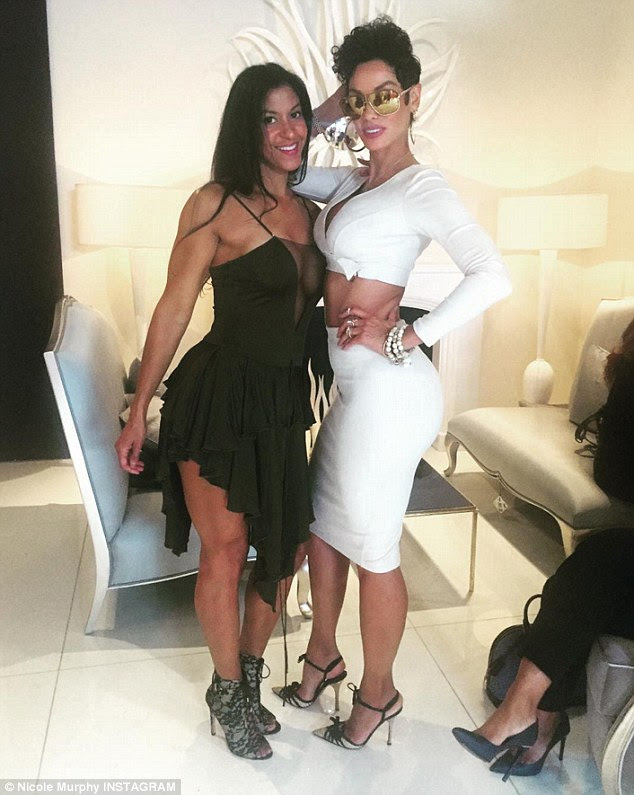 Fitness fan:Giving a little insight into how she maintains her rocking body, Nicole posed up with celebrity trainer Natalie Yco