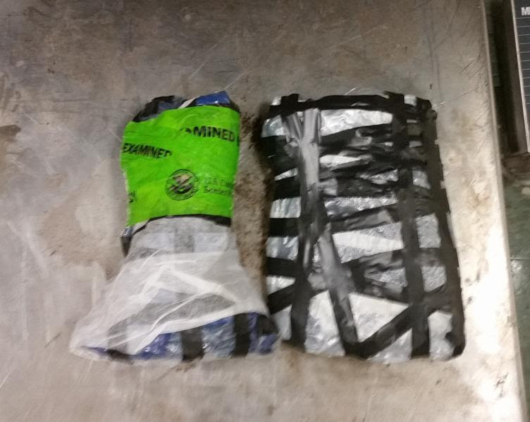 Two packages containing a total of 2.6 pounds of methamphetamine seized by CBP officers at Brownsville Port of Entry