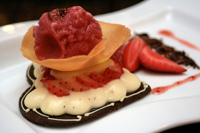 Chocolate duet of sable cookie, white chocolate ganache, strawberry slices and raspberry sorbet
