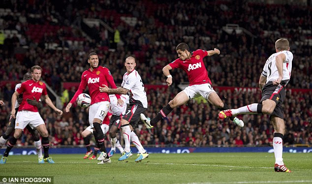 ... Hernandez contorts his body to flick the ball on the volley into the Liverpool net while in mid-air