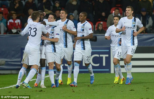 Dream start: Manchester City celebrate their winning start to the Champions League campaign