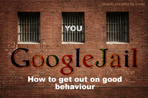 "A picture of a brick wall with barred windows and the words ""YOU in GoogleJail"" - ""How to get out on good behaviour"""