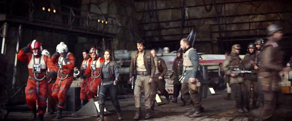 Several X-Wing pilots run past Jyn Erso and Diego Luna's Rebel officer as they are about to embark on their top secret mission in ROGUE ONE: A STAR WARS STORY.