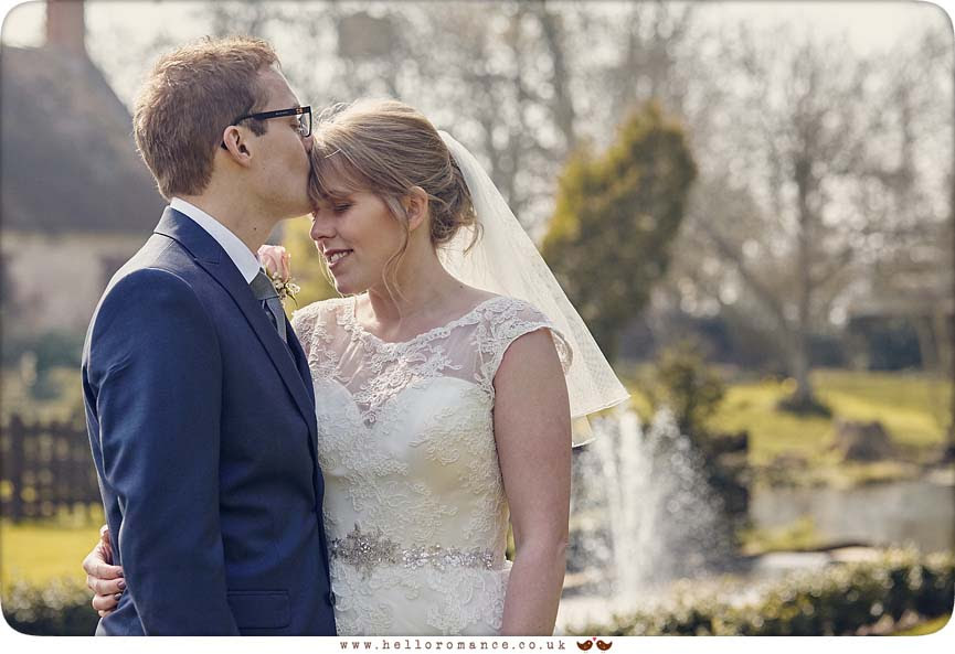 Groom kissing bride on forehead - www.helloromance.co.uk