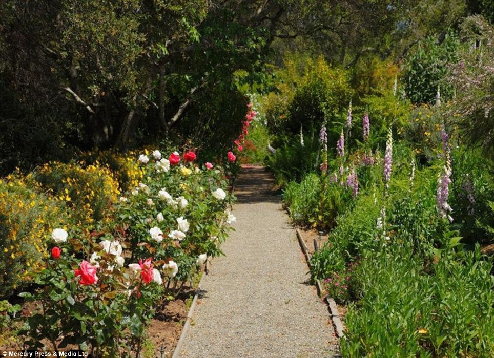 Soothing: The new owners will be able to stroll amongst rows of flowerbeds
