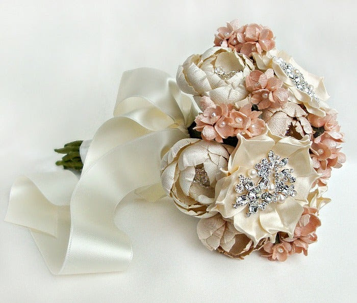 This silk fabric bridal bouquet is comprised of hand cut and formed flowers