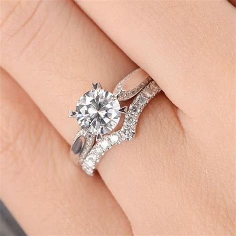 Top 25  best Curved wedding band ideas on Pinterest   Pear