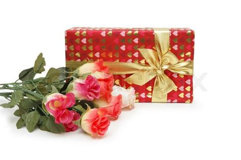Gift box and bunch of flowers isolated on white   Stock