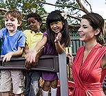 Children with teacher on playground