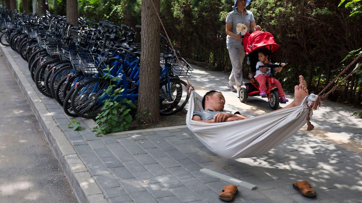 """Chinas Führung ist alarmiert: Junge Chinesen wollen lieber """"flachliegen"""""""