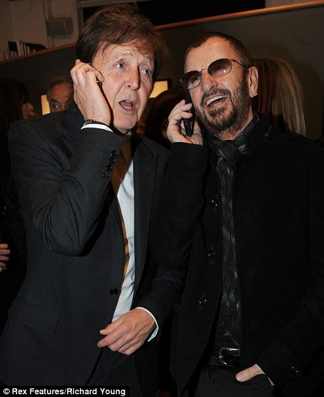 Call: The two Beatles talk on the telephone, looking closer than ever