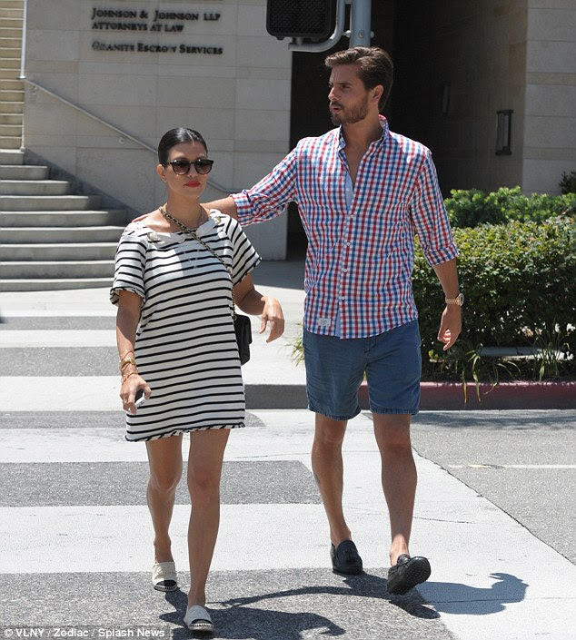 Real life drama: Kourtney Kardashian and boyfriend Scott Disick are seen leaving a lawyer's office after it emerged that the reality star is the subject of a lawsuit after a male model alleged HE is the father of her child