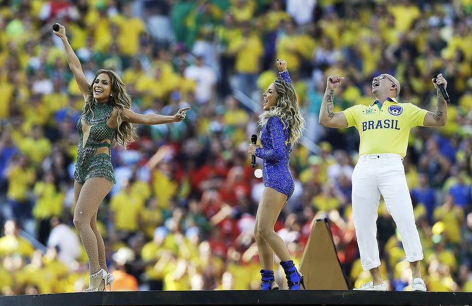 US singer Jennifer Lopez, left, rapper Pitbull and Brazilian singer Claudia Leitte perform during the opening ceremony.