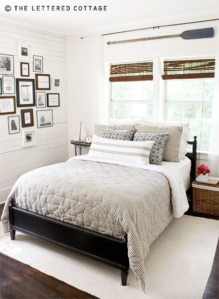 Coastal Bedroom with a wood plank wall.  Love the gallery wall and gray bedding from The Lettered Cottage.  |  Friday Favorites at www.andersonandgrant.com